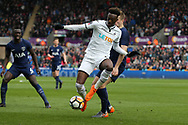 Tammy Abraham of Swansea city gets the ball ahead of Eric Dier of Tottenham Hotspur. The Emirates FA Cup, quarter-final match, Swansea city v Tottenham Hotspur at the Liberty Stadium in Swansea, South Wales on Saturday 17th March 2018.<br /> pic by  Andrew Orchard, Andrew Orchard sports photography.
