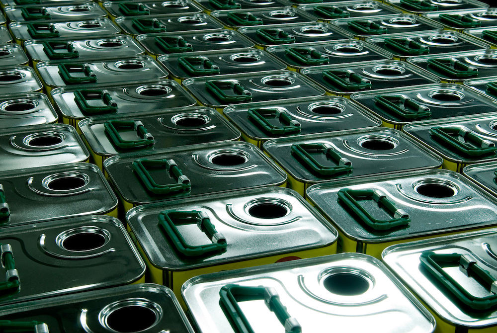 stacks of empty 5 litre olive oil containers at the warehouse