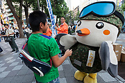 Touchi, a mascot for the Tokyo area Japanese Self Defence Force (JSDF) greats pedestrians in Ikebukuro, Tokyo, Japan Friday September 29th 2017. The Ministry of Defence, each Autumn starts a recruitment drive to encourage more young people to join the Japanese Self Defence Force. Military service in Japan is neither compulsory nor popular and with regional tensions increasing and Hawkish politicians in power they are gain to raise the number of military personnel available.