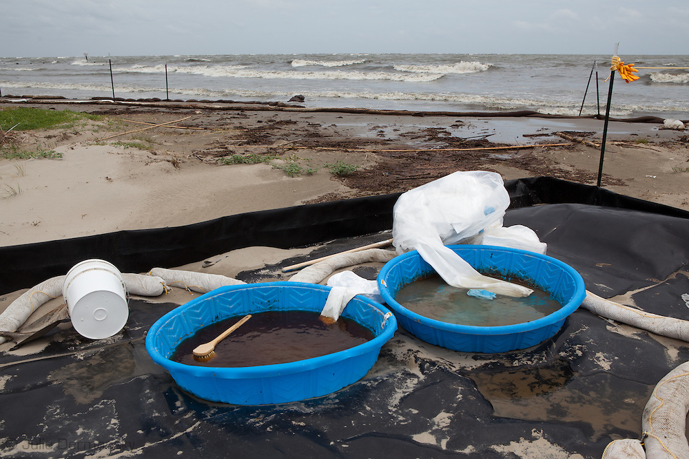 Decontamination pools on left behind by cleanup crews as Alex moves into the Gulf of Mexico and the clean up of the BP oil spill stops temporarily.
