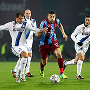Trabzonspor's Burak YILMAZ (C) and Inter's Dejan STANKOVIC (L), Javier ZANETTI (R) during their UEFA Champions League group stage matchday 5 soccer match Trabzonspor between Inter at the Avni Aker Stadium at Trabzon Turkey on Tuesday, 22 November 2011. Photo by TURKPIX