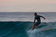 30th May 2011: Dane Pioli hangs five surfing at Snapper Rocks on the Gold Coast, Queensland, Australia. Photo by Matt Roberts / Nikon