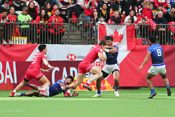 March 9, 2019 - Vancouver, BC, U.S. - VANCOUVER, BC - MARCH 09:  Matt Mullins (1) of Canada tries to run by Tofatu Solia (1) of Samoa during day 1 of the 2019 Canada Sevens Rugby Tournament on March 9, 2019 at BC Place in Vancouver, British Columbia, Canada. (Photo by Devin Manky/Icon Sportswire) (Credit Image: © Devin Manky/Icon SMI via ZUMA Press)