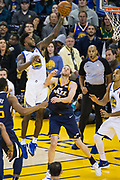 Golden State Warriors forward Jordan Bell (2) takes the ball to the basket against the Utah Jazz at Oracle Arena in Oakland, Calif., on December 27, 2017. (Stan Olszewski/Special to S.F. Examiner)