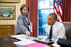 President Barack Obama is briefed by Lisa Monaco, Assistant to the President for Homeland Security and Counterterrorism, on the shooting in Canada prior to a phone call to Canadian Prime Minister Stephen Harper, Oct. 22, 2014. (Official White House Photo by Pete Souza)<br /> <br /> This official White House photograph is being made available only for publication by news organizations and/or for personal use printing by the subject(s) of the photograph. The photograph may not be manipulated in any way and may not be used in commercial or political materials, advertisements, emails, products, promotions that in any way suggests approval or endorsement of the President, the First Family, or the White House.