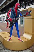 Spiderman plays the guitar on the first day of MCM Comic Con 2019 at Excel centre on 25th October 2019 in London, England, United Kingdom.