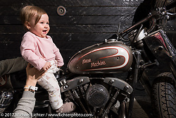 One year old Tasia Kostin on a LeeColn custom Shovelhead at the Custom and Tuning Show, the custom bike show portion of the big Motor Spring bike show in Moscow, Russia. Sunday April 23, 2017. Photography ©2017 Michael Lichter.
