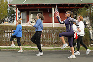 Barbara Sessa, front right, leads a group of runners in a drill on a street near the Middletown YMCA on Tuesday, April 21, 2009. Sessa is teaching a six-week clinic on running at the YMCA.