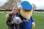 AFC Wimbledon fan holding ball with Haydon the Womble during the EFL Sky Bet League 1 match between AFC Wimbledon and Gillingham at the Cherry Red Records Stadium, Kingston, England on 23 March 2019.