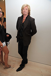 NICKY CLARKE at an exhibition of photographic portraits by Bryan Adams entitled 'Hear The World' at The Saatchi Gallery, King's Road, London on 21st July 2009.