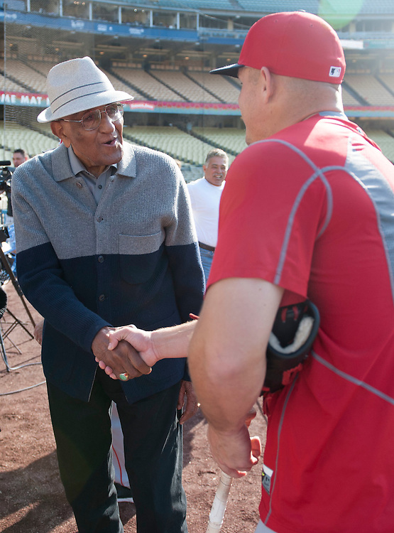 Dodger great Don Newcombe says hello to Mike Trout before the Angels game Tuesday night at Dodger Stadium.<br /> <br /> / //ADDITIONAL INFO:   <br /> <br /> angels.0518.kjs  ---  Photo by KEVIN SULLIVAN / Orange County Register  -- 5/17/16<br /> <br /> The Los Angeles Angels take on the Los Angeles Dodgers in inter-league play at Dodger Stadium Tuesday night.