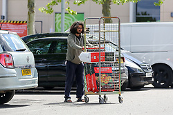 © Licensed to London News Pictures. 02/05/2020. London, UK. A man with bags of compost outside Homebase in Haringey, north London, after the store opened following the COVID-19 lockdown. The government has ordered that people go out for one form of exercise a day, shopping for basic necessities, any medical need, to provide care or to help a vulnerable person and travel to and from work and to keep 2 meters away from other people at all times to slow the spread of the coronavirus and reduce pressure on the NHS. Photo credit: Dinendra Haria/LNP