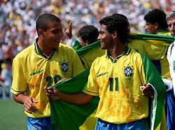 Brazil's Ronaldo (an unused sub) celebrates winning the 1994 World Cup Final against Italy with Romario (r)