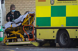 © Licensed to London News Pictures.22/01/2021, London,UK. A patient is transferred on stretcher from an ambulance at Queen's Hospital in Romford, east London as the number of coronavirus cases surge as the capital's hospitals struggle to cope with the number of patients. Photo credit: Marcin Nowak/LNP