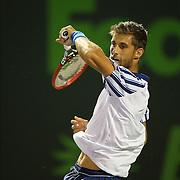 Martin Klizan, of Slovakia, returns a shot against Novak Djokovic, of Serbia at the Miami Open tennis tournament on Saturday, March 28, 2015 in Key Biscayne, Florida. Djokovic defeated Klizan 6-0, 5-7, 6-1(AP Photo/Alex Menendez)