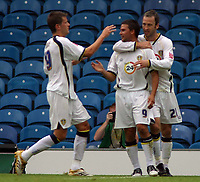 Photo: Paul Thomas.<br /> Leeds United v Norwich City. Coca Cola Championship.<br /> 05/08/2006.<br /> <br /> David Healy of Leeds celebrates his goal with Eirik Bakke (L) and Shaun Derry (R).