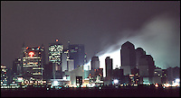 September 13, 2001: The Travelers Building at 388 Greenwich Street shows signs of rain<br /> falling on a smoldering ground zero after terrorists flew two hijacked airplanes into two<br /> World Trade Centers in lower Manhattan in New York City tuesday morning. 2,713 people<br /> were killed by Islamic terrorist Osama bin Laden as he declares The Jihad (Holy War)<br /> against The United States of America. View from Hoboken, NJ. ©2001ShellyCastellano.com<br /> <br /> ________________________________<br /> 13 September 2001: View of smoke smoldering ashes burning in the rain only two days after the Terrorist attack on the America's. View of  Lower Manhattan, NY from Hoboken NJ. Area surrounding ground zero where the World Trade Centers WTC once stood only hours after they fell to the ground in New York.  Islamic terrorist Osama bin Laden declares The Jihad or Holy War against The United States of America on September 11, 2001. Headline news photos available for editorial use.