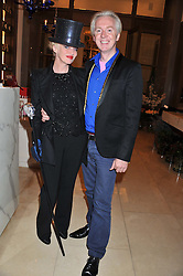 PHILIP TREACY and URSULA FLANNERY at a dinner hosted by Pablo Ganguli and Ella Krasner to celebrate the 10th Anniversary of Liberatum and in honour of Sir Peter Blake held at The Corinthia Hotel, Nortumberland Avenue, London on 23rd November 2011.