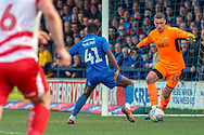 Doncaster Rovers goalkeeper Marko Marosi (13) trying to dribbling around AFC Wimbledon attacker Michael Folivi (41) during the EFL Sky Bet League 1 match between AFC Wimbledon and Doncaster Rovers at the Cherry Red Records Stadium, Kingston, England on 9 March 2019.