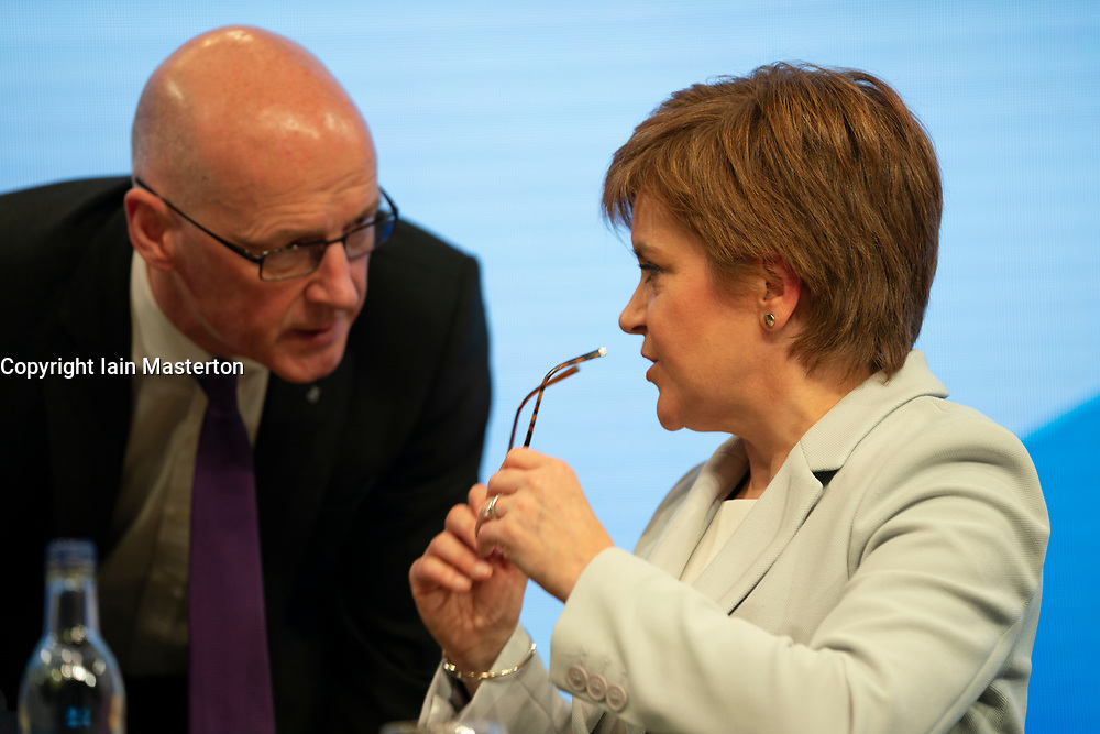 Edinburgh, Scotland, UK. 27 April, 2019. SNP ( Scottish National Party) Spring Conference takes place at the EICC ( Edinburgh International Conference Centre) in Edinburgh. Pictured; First Minister Nicola Sturgeon talks with John Swinney on Day 1 of the conference