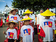 06 NOVEMBER 2015 - YANGON, MYANMAR: People stand at the start of the final NDF election rally of the 2015 election. The rally was held in central Yangon, next to the historic Sule Pagoda and across the street from Yangon city hall. The National Democratic Force (NDF) was formed by former members of the National League for Democracy (NLD) who chose to contest the 2010 general election in Myanmar because the NLD boycotted that election. There have been mass defections from the NFD this year because many of the people who joined the NFD in 2010 have gone back to the NLD, which is contesting this year's election and widely expected to win it. Campaigning in the Myanmar election ended Friday. People go to the polls Sunday.     PHOTO BY JACK KURTZ
