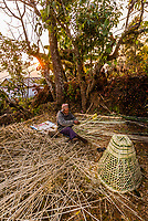Man weaving bamboo baskets, Lekhnath, Kathmandu Valley, Nepal.