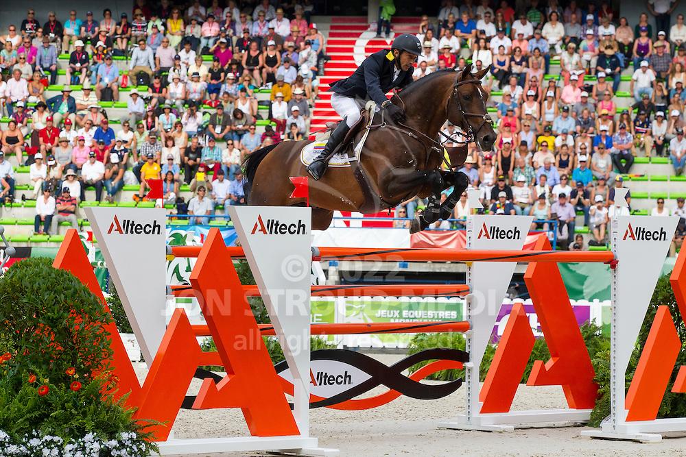 Dayro Arroyave, (COL), Eldorado vh Vijverhof - World Champions, - Second Round Team Competition - Alltech FEI World Equestrian Games™ 2014 - Normandy, France.<br /> © Hippo Foto Team - Leanjo De Koster<br /> 25/06/14