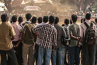 Indian men watching a motocross race in Cochin