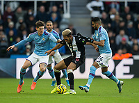 Football - 2019 / 2020 Premier League - Newcastle United vs. Manchester City<br /> <br /> Joelinton of Newcastle United vies with Riyad Mahrez of Manchester City and John Stones of Manchester City, at St James' Park.<br /> <br /> COLORSPORT/BRUCE WHITE