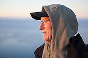 Parmenter Welty watches the sun rise from Vaeroy Island, Lofoten Islands, Norway.