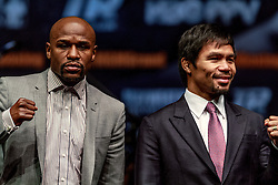 LOS ANGELES, CA - MAR 10 Floyd Mayweather and Manny Pacquiao pose for the press after the Mayweather vs Pacquiao press conference at the Nokia Theater in Los Angeles, California USA to promote their upcoming bout at the MGM Grand in Las Vegas, NV May 2, 2015. This is the ony presser. 2015 Feb 9. Byline, credit, TV usage, web usage or linkback must read SILVEXPHOTO.COM. Failure to byline correctly will incur double the agreed fee. Tel: +1 714 504 6870.