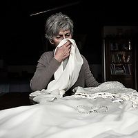 Giovanna Ferrari holds Giulia Galiotto wedding dress. She handstitched it for her daughter. She told me that she still smells her daughter's scent. That day she told me that there is always the suspicion surrounding her and his husband that they didn't do enough to prevent the tragedy, that they weren't able to understand their daughter. It is a silent insinuation that comes from strangers, even during public meetings.
