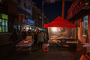 A view of a night market in the Erdaojiang district in Tonghua, Jilin province, China, on Wednesday, Jan. 6, 2016. The citys once-vaunted state-run steel mills have slipped inexorably into decline, weighed down by slumping global markets, a changing economy, and the burden of costs and responsibilities to the people of the town they fostered. Previous attempts to privatise the enterprise have met with stiff resistance, one such attempt resulted the mob lynching and death of a private businessman who wanted to invest and streamline the operation.