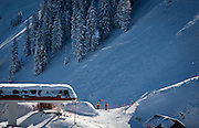 Ski patrol members stand at the top of a chairlift near the site of a small avalanche at Canyons Resort, Wednesday, Dec. 19, 2012