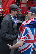 After threee and a half years of political upheavel in the British parliament, a young man styled like the Peaky Blinders (a 1930s gangster TV show) is alongside other Brexiteers celebrating in Westminster on Brexit Day, the day when the UK legally leaves the European Union, on 31st January 2020, in London, England.