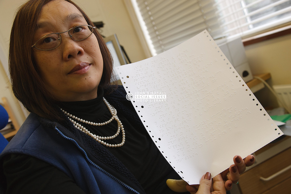 Woman who has long-term illness and reduced mobility following a car accident, helped into employment by the Ready 4 Work team, Nottinghamshire County Council, shows page of Braille she has transcribed from text