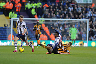 West Brom's James Morrison (l) breaks away as Hull city's Jake Livermore ® slides in on Stephane Sessegnon. Barclays Premier league, West Bromwich Albion v Hull city at the Hawthorns in West Bromwich, England on Saturday 21st Dec 2013. pic by Andrew Orchard, Andrew Orchard sports photography.