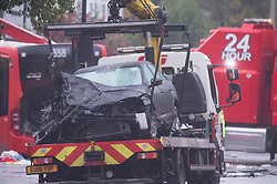 ©Licensed to London News Pictures 01/11/2019.<br /> Orpington,UK.A car on a recovery truck. One person is dead and 15 others have been injured in a crash between two buses and a car last night in Orpington, South East London. A man has been arrested for dangerous driving. Police are still on scene and a cordon is in place. Photo credit: Grant Falvey/LNP