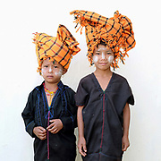 Portrait of PaO ethnic minority children at the PaO National Day on 24th March 2016 in Kayah State, Myanmar  at the PaO National Day on 24th March 2016 in Kayah State, Myanmar. The PaO origin story states that they are derived from a shaman, Zawgyu, and a female dragon so the women fashion their turban to resemble a dragons head photo by Tessa Bunney/In Pictures via Getty Images