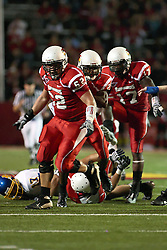 26 September 2009: Protected by Mike Piton in front and Paul Wright in back, Chris Garrett heads to the goal after intercepting a pass intended for Glen Fox (17) in a game which the South Dakota State Jackrabitts jump past the Illinois State Redbirds 38 - 17 at Hancock Stadium on campus of Illinois State University in Normal Illinois