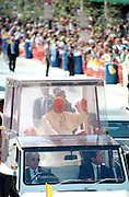 Pope John Paul II waves from inside the popemobile during his visit October 8, 1995 in Baltimore, Maryland.