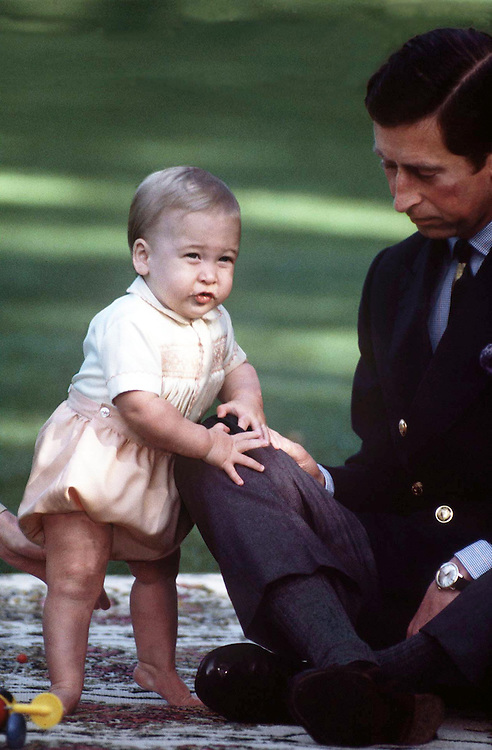 Prince William seen with his father the Prince of Wales in the agrden of Government House, Auckland, New Zealand during one of his early photocalls for the media. May 1983. Photographed by Jayne Fincher