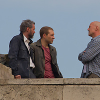 US actor Bruce Willis (R) with costars Jai Courtney (C) of Australia and Sebastian Koch (L) of Germany are seen during a shooting of the fifth piece in the Die Hard series titled Good Day to Die Hard during a shooting day in Budapest, Hungary on May 19, 2012. ATTILA VOLGYI