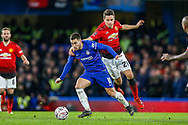 Manchester United Midfielder Ander Herrera (21) holds back Chelsea forward Eden Hazard (10) during the The FA Cup match between Chelsea and Manchester United at Stamford Bridge, London, England on 18 February 2019.