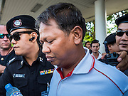 22 MAY 2015 - BANGKOK, THAILAND: Thai police arrest an anti-coup protestor at Lat Phrao subway stop in Bangkok. The Thai military seized power in a coup on May 22, 2014. There were small protests throughout Bangkok Friday to mark the first anniversary of the coup. Police arrested protestors at several locations. The most serious protest was at Bangkok Art and Culture Centre (BACC) where about 100 protestors, mostly students, faced off against police for several hours. Police made numerous arrests at the BACC protest.      PHOTO BY JACK KURTZ
