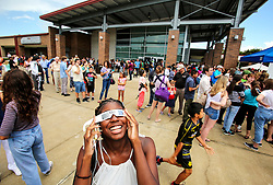 SSC student Cana Key looks toward the sky during an Eclipse 2017 Observing Event at Seminole State College on Monday afternoon, Aug. 21, 2017. The Buehler Planetarium at Seminole State College hosted the event and had filtered telescopes and binoculars set up for viewing the eclipse. They also handed out viewing glasses for the first 5,000 visitors. Photo by Jacob Langston/Orlando Sentinel/TNS/ABACAPRESS.COM