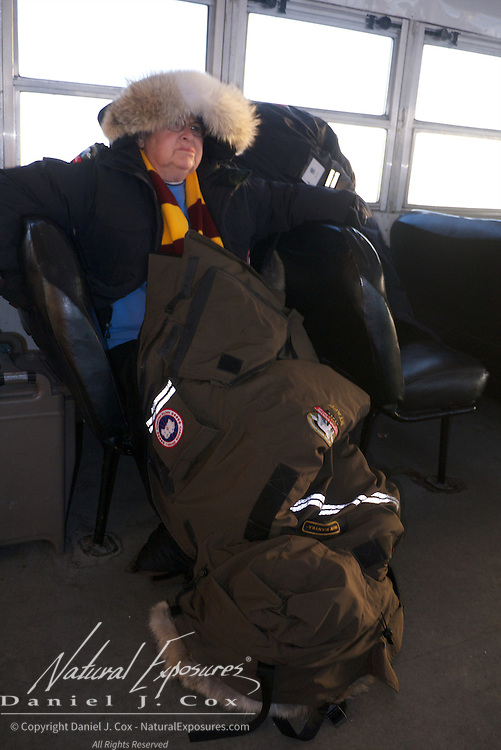 Jill Hewiker tries to stay warm with two Canada Goose parkas while viewing polar bears at Cape Churchill, Hudson Bay, Manitoba.