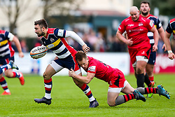 Jordan Williams of Bristol Rugby is tackled by Joel Dudley of Jersey Reds - Rogan/JMP - 28/10/2017 - RUGBY UNION - Stade Santander International - St Peter, Jersey - Jersey Reds v Bristol Rugby - Greene King IPA Championship.