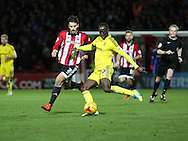 Middlesbrough midfielder Albert Adomah surging past Brentford defender Maxim Colin during the Sky Bet Championship match between Brentford and Middlesbrough at Griffin Park, London, England on 12 January 2016. Photo by Matthew Redman.