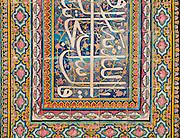 Decorated tiled islamic inscription at Nasir al-Mulk Mosque, (aka the Pink Mosque) Shiraz, Iran. Built 1876 -1888. Architects: Muhammad Hasan-e-Memar and Muhammad Reza Kashi Paz-e-Shirazi.